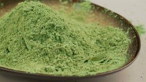 Pudrat grönt te för matcha, selektiv fokus lager videofilmer