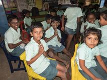 Happy children friends classmates smiling with hands joint gesture at the school in classroom. School kids enjoying friendship stock images