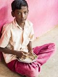 Sad alone teenagers pupils being served Meal plate of rice In government School Canteen. Unhealthy food for poor children. PUDUCHERRY, TAMIL NADU, INDIA royalty free stock images