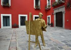 Puebla, Mexico-November 6, 2016: Statue of a man painting in the square Royalty Free Stock Photo