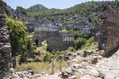 Pueblo abandonado de Kayakoy, cerca de Hisaronu, Turquía Imágenes de archivo libres de regalías