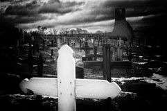 Pueblo Cemetery. Dark and gloomy black and white image of the old cemetery in Taos Pueblo in New Mexico. Added extra grain for effect stock photo