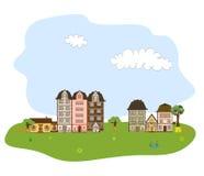 Pueblo, ciudad o vecindad hermosa en h verde Foto de archivo