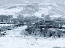 Pueblo de montaña del invierno Fotografía de archivo