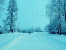 Pueblo ruso en la estación del invierno Imagen de archivo