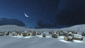 Pueblo sitiado por la nieve en la noche del invierno de las nevadas Imagenes de archivo
