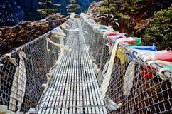 Puente colgante en Nepal Imagen de archivo libre de regalías