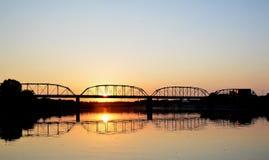 Puente de acero en la puesta del sol Imagen de archivo libre de regalías