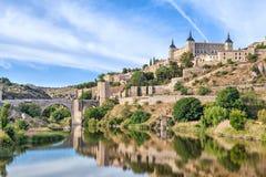 Puente de Alcantara and Alcazar de Toledo Stock Photography