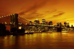 Puente de Brooklyn y Manhattan en la puesta del sol, Nueva York Foto de archivo libre de regalías