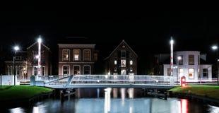 Puente de la bicicleta por noche Imagenes de archivo