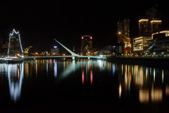Puente de la Mujer. Puerto Madero, also known within the urban planning community as the Puerto Madero Waterfront, is a barrio (district) of the Argentine Stock Photos