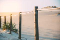 Puente de madera del pie en la playa Imagen de archivo libre de regalías