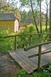 Puente de madera por el watermill Fotos de archivo libres de regalías