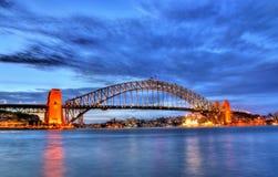 Puente de puerto de Sydney en la puesta del sol Imagen de archivo