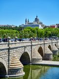 Puente de Segovia bridge crossing the gardens of Madrid Rio. Madrid, Spain - May 15, 2018. Puente de Segovia bridge crossing the gardens of Madrid Rio at spring royalty free stock images