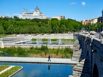 Puente de Segovia bridge crossing the gardens of Madrid Rio. Madrid, Spain - May 15, 2018. Puente de Segovia bridge crossing the gardens of Madrid Rio at spring royalty free stock photo