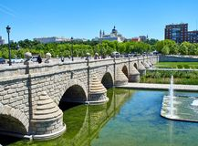 Puente de Segovia bridge crossing the gardens of Madrid Rio. Madrid, Spain - May 15, 2018. Puente de Segovia bridge crossing the gardens of Madrid Rio at spring royalty free stock photos