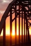 Puente del arco en puesta del sol Fotografía de archivo libre de regalías