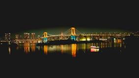 Puente del arco iris en la noche imágenes de archivo libres de regalías