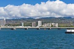 Puente en el agua azul Imagenes de archivo