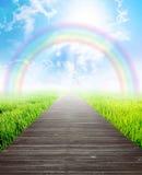 Puente en paisaje del verano con el arco iris Fotos de archivo