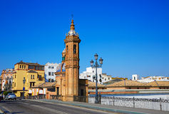 Puente Isabel II bridge in Triana Seville Spain. Puente Isabel II bridge Capilla del Carmen in Triana Seville of Andalusia Spain Stock Photos