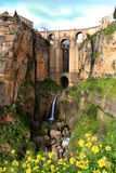 Puente Nuevo bridge, in Ronda, Spain. Puente Nuevo bridge at evening time in Ronda with waterfall, Andalucia, Spain royalty free stock photography
