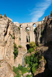 Puente Nuevo bridge and white houses in Ronda, Spain. Low-angle view of the famous Puente Nuevo & x28;new Bridge& x29; over the Guadalevin river in the Stock Photo