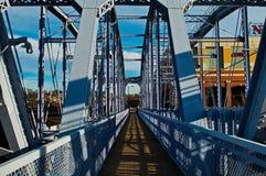 Puente púrpura de la gente Imagen de archivo libre de regalías
