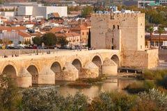 Roman bridge and Calahorra Tower, Cordoba, Spain. Puente Romano or Roman bridge across Guadalquivir river and Torre de Calahorra or Calahorra Tower in sunny day stock photo