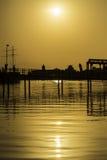Puente sobre el río en la puesta del sol Imagen de archivo