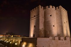 Puente y torre medieval. Night partial view of the Roman brigde and the tower of medieval origin Royalty Free Stock Image
