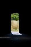 Puerta abierta de la fábrica oscura Fotos de archivo