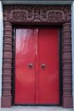 Puerta antigua roja Fotografía de archivo libre de regalías