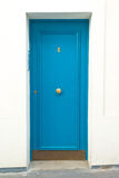 Puerta azul de la casa Foto de archivo libre de regalías
