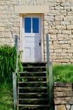 Puerta blanca, casa de piedra foto de archivo libre de regalías