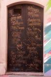 Puerta con la escritura adornada Fotografía de archivo libre de regalías