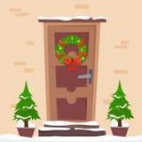 Puerta con la guirnalda de la Navidad imagenes de archivo