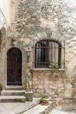 Puerta con la ventana barrada Foto de archivo libre de regalías