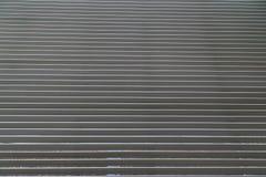 Puerta de acero rodada del obturador Imagen de archivo libre de regalías