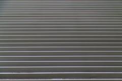 Puerta de acero rodada del obturador Foto de archivo libre de regalías