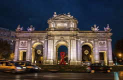 Puerta de Alcalá building and big red ribbon symbolizing AIDS international day Royalty Free Stock Photos