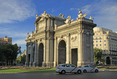 The Puerta de Alcala (Alcala Gate) on the Plaza de la Independencia (Independence Square) in Madrid, Spain Stock Photography