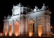 Puerta de Alcala at Night. The Puerta de Alcala (Alcala Gate) is a monument in the Plaza de la Independencia (Independence Square) in Madrid, Spain.  It was Stock Image