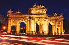 The Puerta de Alcala at night in Madrid Stock Photos