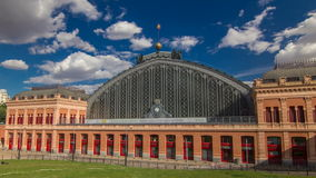 Puerta De Atocha train station building timelapse hyperlapse in Madrid, Spain. Spain's main cities are connected by high-speed trains. 4K stock footage
