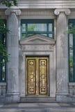 Puerta de cobre amarillo del banco Imágenes de archivo libres de regalías
