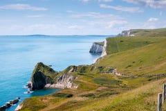 Puerta de Durdle, Dorset en Reino Unido, sitio jurásico del patrimonio mundial de la costa fotografía de archivo
