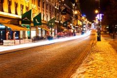 Puerta de Karl Johans en la noche del invierno Imagen de archivo